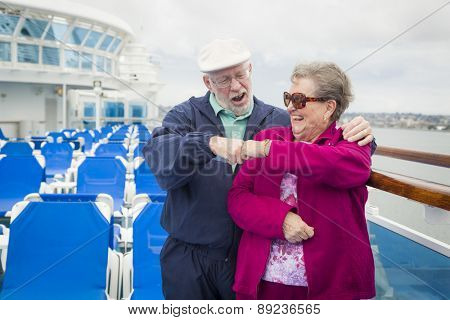 Happy Senior Couple Fist Bump on the Deck of a Luxury Passenger Cruise Ship.