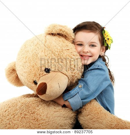 Little Girl With Big Teddy Bear Having Fun Laughing