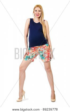 Young pregnant woman in colorful clothing isolated on white