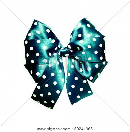 dark cyan bow with white polka dots made from silk isolated