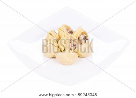 Pasta shells on stuffed with mushrooms.