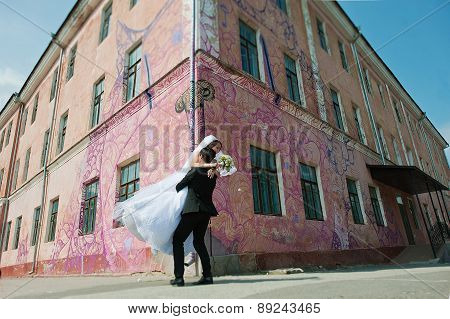 Young Beautiful Wedding Couple At The Graffity Wall