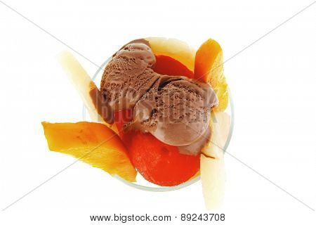 fresh raw  tropical fruits with chocolate ice cream in big glass isolated on white background