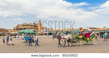 MARRAKESH, MOROCCO, APRIL 3, 2015: Jemaa el-Fnaa square -  Horse drawn carriage waits for tourists