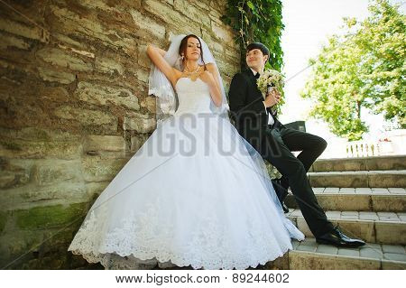 Young Beautiful Wedding Couple At The Wall
