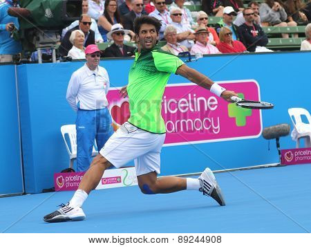 Fernando Verdasco slides after a backhand