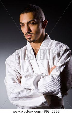 Karate player in dark room