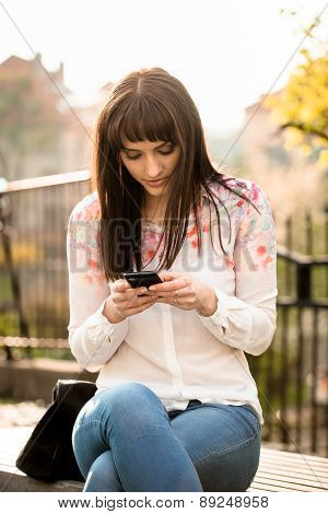 Woman looking to phone