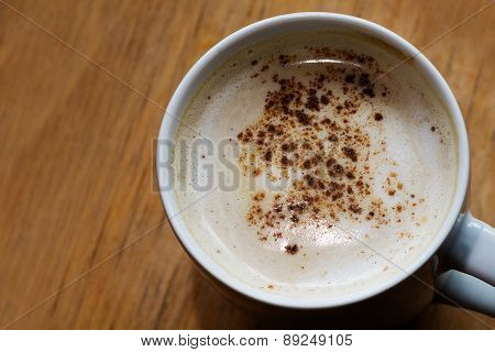 Coffee With Milk Foam And Cocoa On A Wooden Table, Copy Space