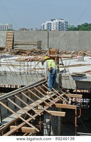 Group of construction worker fabricating beam timber formwork