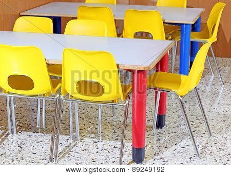Classroom With Chairs And Tables In The Kindergarten
