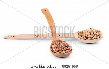 Wooden spoons with pistachios.