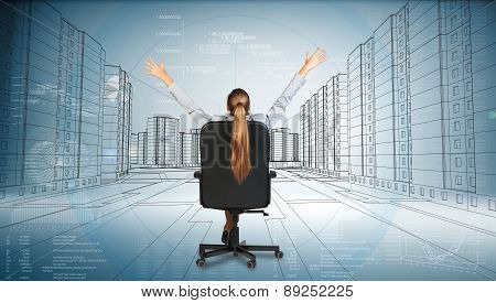 Rear view of businesswoman with hands up