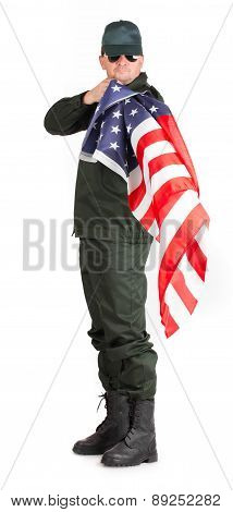 Man in workwear stands with american flag.