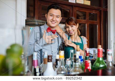 Cheerful barman and waitress