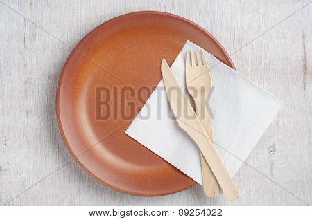 Empty Plate With Wooden Fork And Knife