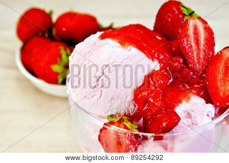 Ice cream strawberry in glass bowl on fabric