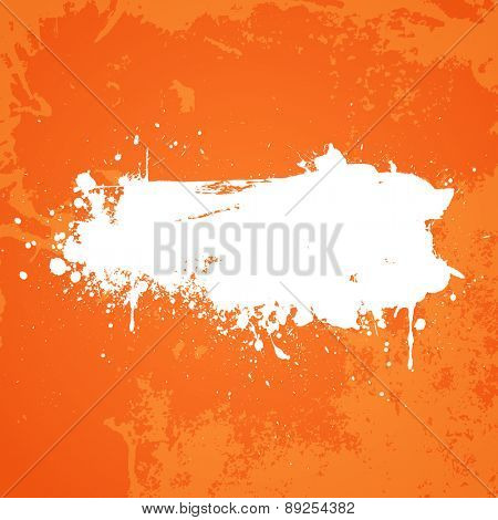 Orange grunge background with white splat in the centre