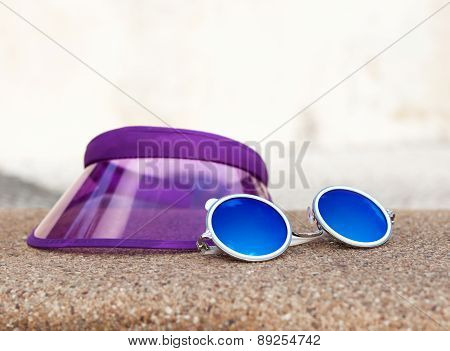 Sun Lotion And Sunglasses On The Beach