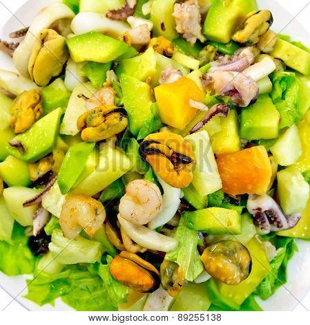 Salad seafood and avocado on top
