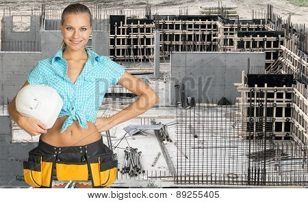 Young woman holding hard hat