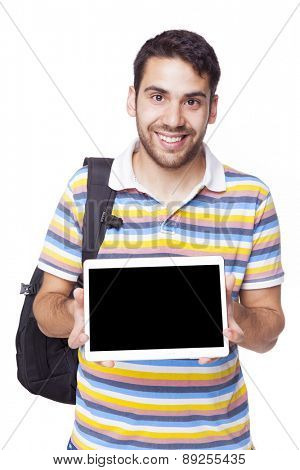 Smiling student displaying a tablet computer, isolated on white background