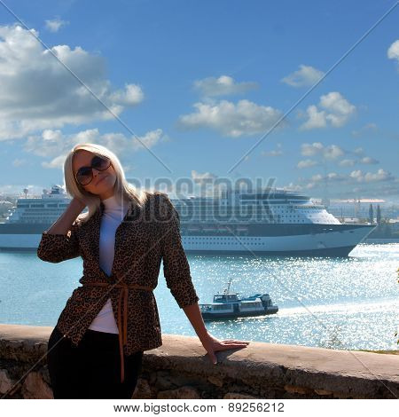 Beautiful Blonde On The Background Of A Cruise Ship
