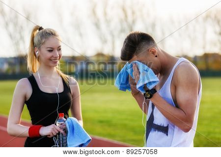 a beautiful young couple resting after running