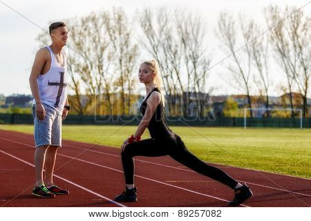 Young Health Couple Doing Stretching Exercise Relaxing And Warm Up After Jogging And Running