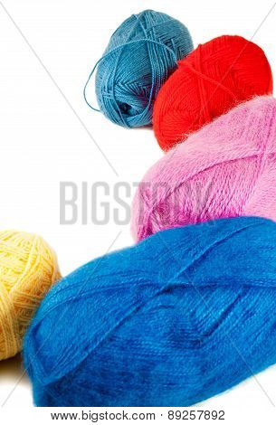 Close Up Of Wool Knitting On White Background. Selective Focus