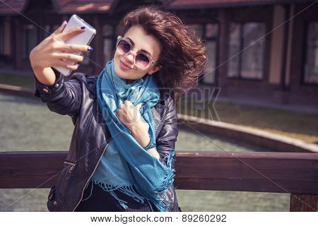 Brunette Beautiful Stylish Caucasian Woman In Casual Outfit On A Walk On European City Street Making