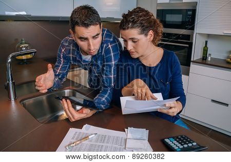 Couple reviewing their accounts with a digital tablet