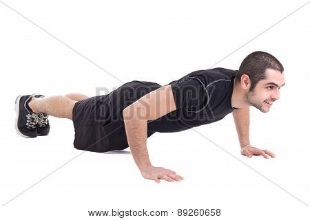 Young Handsome Bearded Arabic Man In Sportswear Doing Push Up Isolated On White