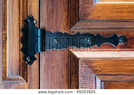 Hinge On An Old Wooden Door