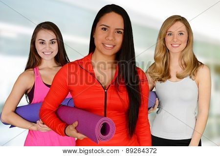 Group of people doing yoga while at the gym