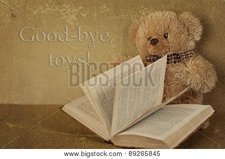small teddy bear with the book