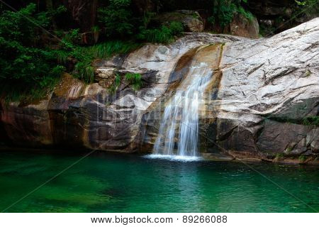 waterfall in the forest, yunnan china.