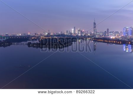 modern nanjing city skyline with the beautiful lake at night.