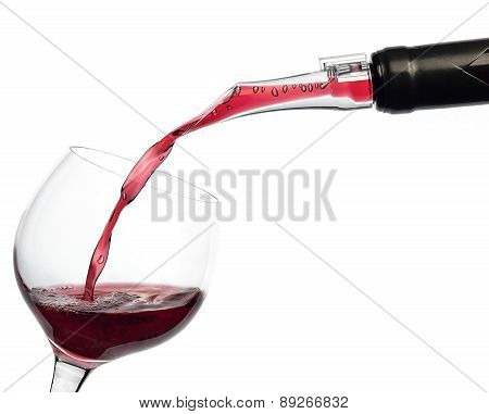 Red Wine Pouring Into A Wine Glass Isolated On White