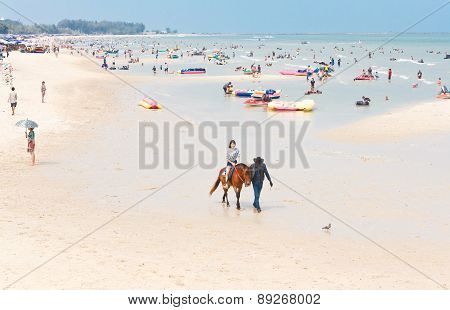 Riding Horses On The Beach.