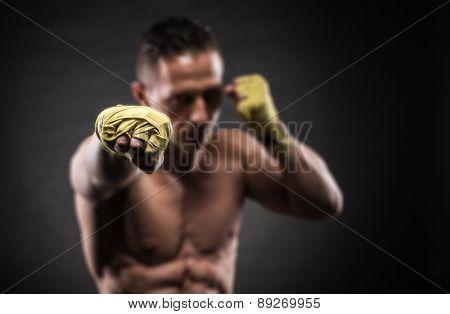 Muscular Man In Studio On Dark Background