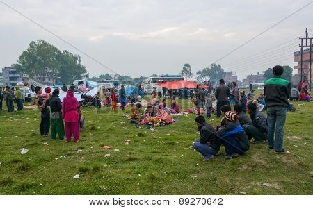 KATHMANDU, NEPAL - APRIL 26, 2015: People stay on an open ground at Chuchepati after their first night outside after the 7.8 earthquake on 25 April 2015.