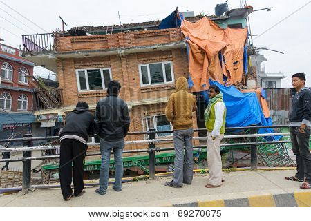 KATHMANDU, NEPAL - APRIL 26, 2015: Partially collapsed house after the 7.8 earthquake hit Nepal on 25 April 2015.