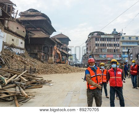 KATHMANDU, NEPAL - APRIL 26, 2015: Rescue team at Durbar Square which was severly damaged after the major earthquake on 25 April 2015.
