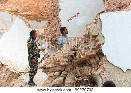 KATHMANDU, NEPAL - APRIL 26, 2015: Rescue effort at the collapsed Dharhara tower after the major earthquake on 25 April 2015.