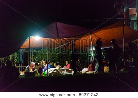 KATHMANDU, NEPAL - APRIL 25, 2015: People prepare to sleep overnight on an open ground at Chuchepati after the 7.8 earthquake hit Kathmandu