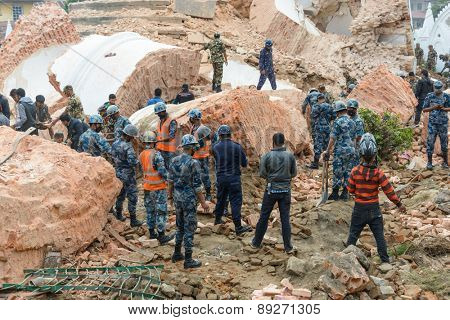 KATHMANDU, NEPAL - APRIL 26, 2015: Nepal Armed Police Force, army, police and civilians start rescue efforts at the collapsed Dharhara tower after the major earthquake on 25 April 2015.