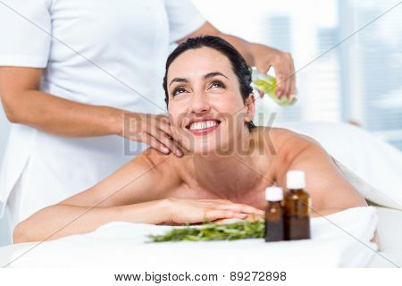 Smiling woman getting an aromatherapy treatment in a healthy spa