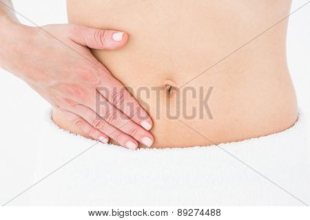 Woman suffering from menstruation pain on white background