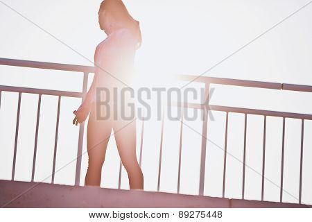 Young girl silhouette at sunset. Freedom and health concept